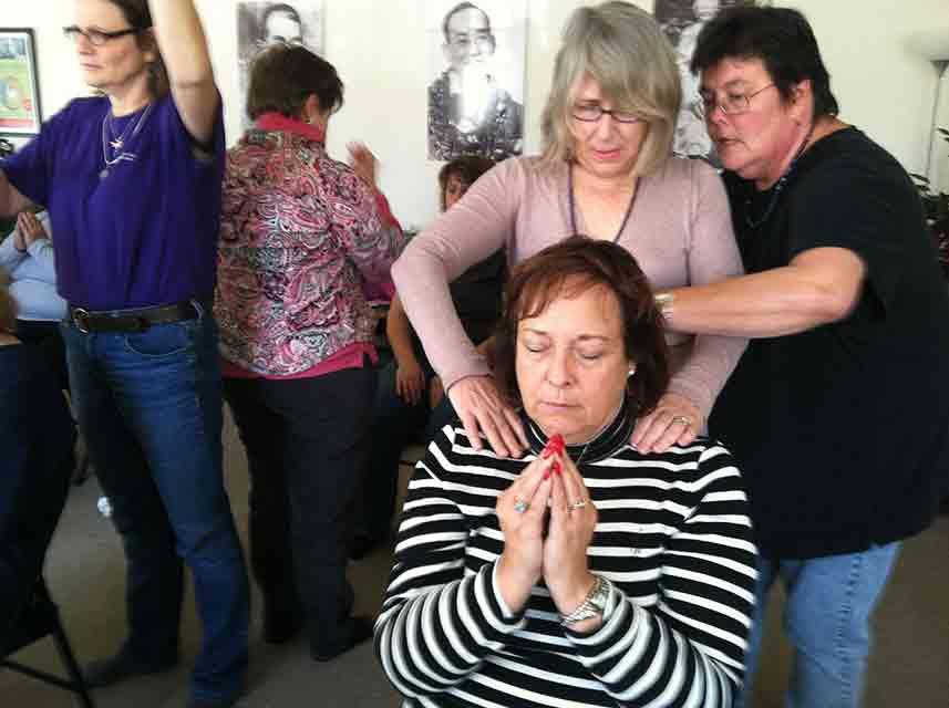 Reiki Master students practice doing a Reiki attunement