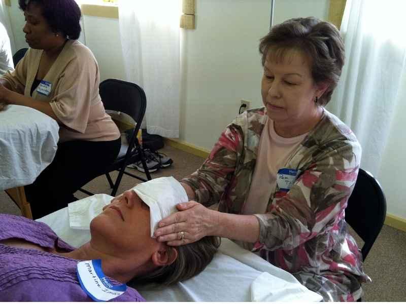 Reiki students practice giving reiki session
